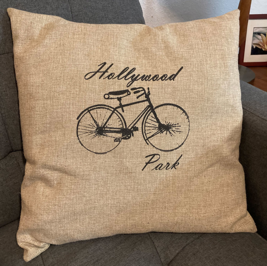 pillow with hollywood park text and bicycle design